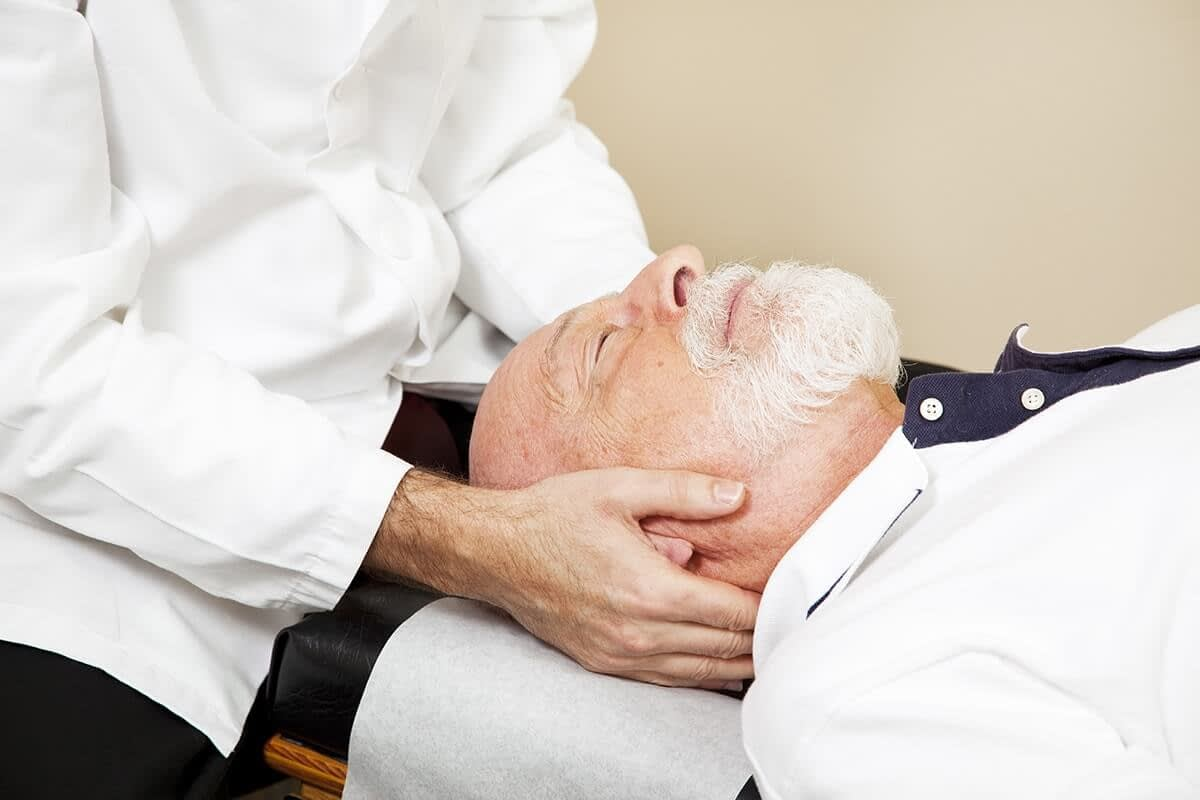 man getting holistic pain relief in Portland Oregon