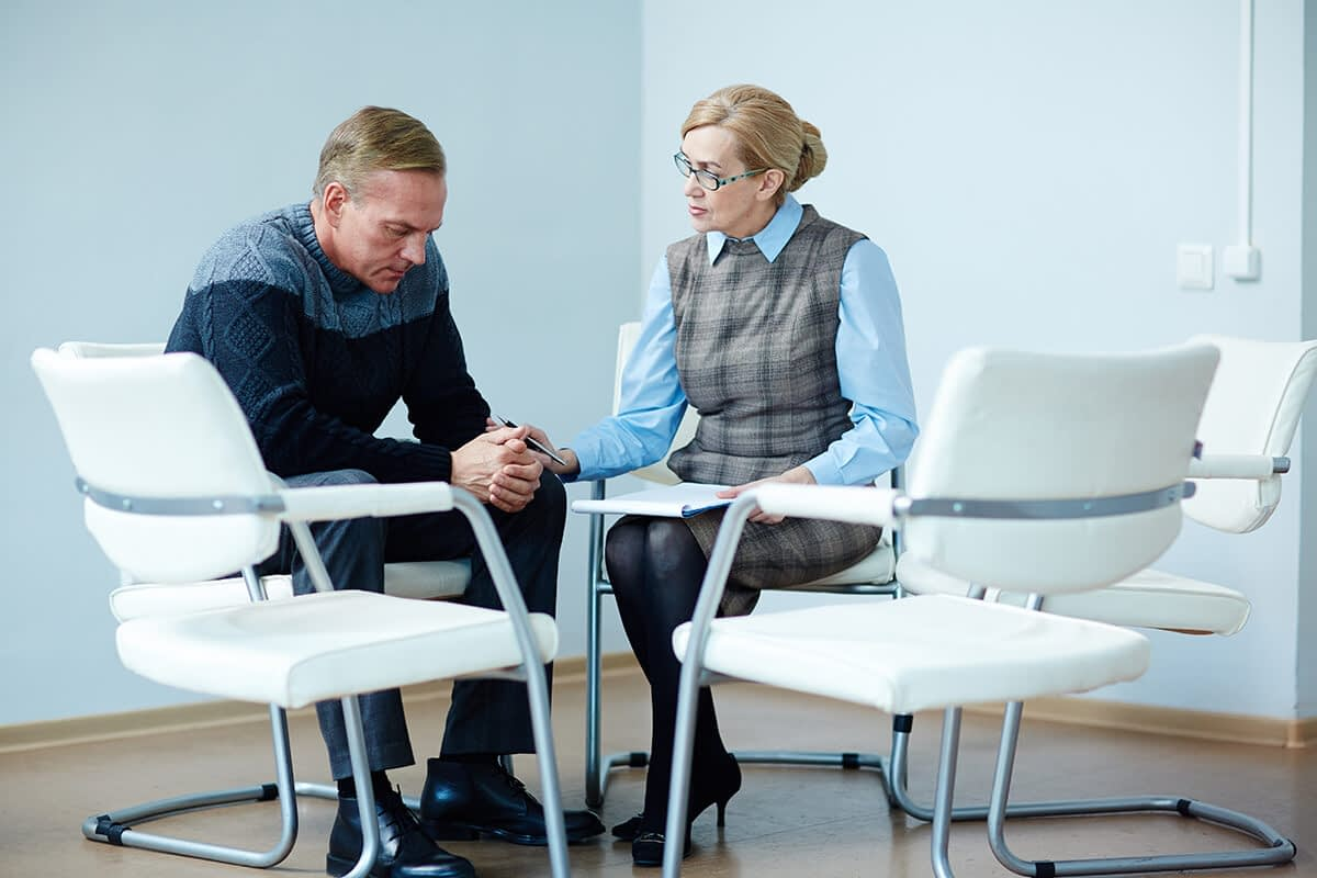 a doctor talking to a patient about the types of psychotherapy