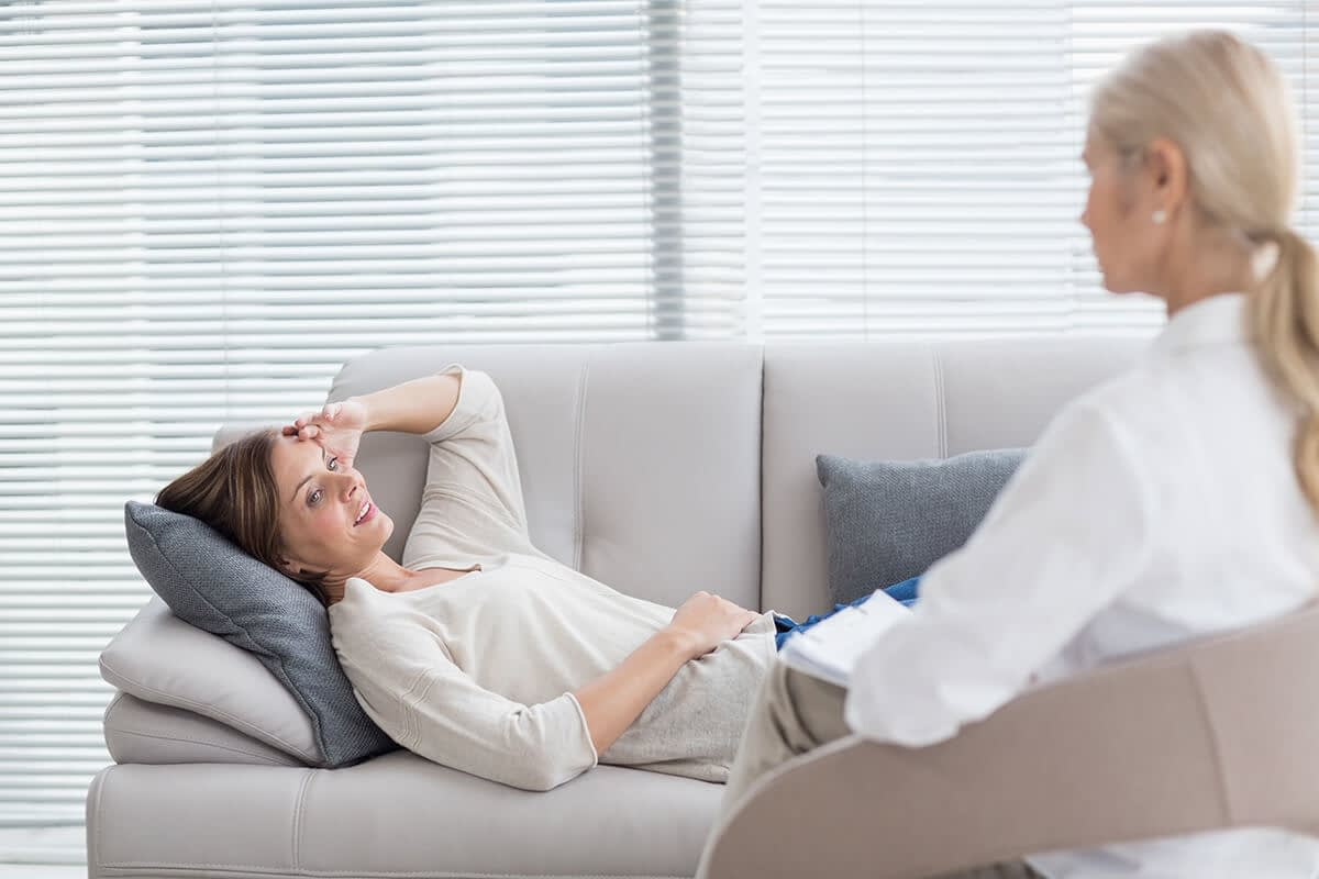 a therapist listens to her client ask what is dual diagnosis treatment