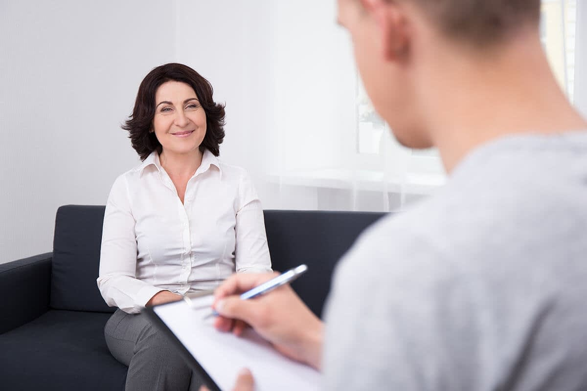 a woman begins the enrollment process at drug and alcohol rehab