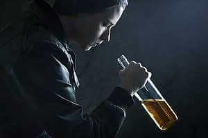 alcohol rehab for young adults young man drinking crestview recovery