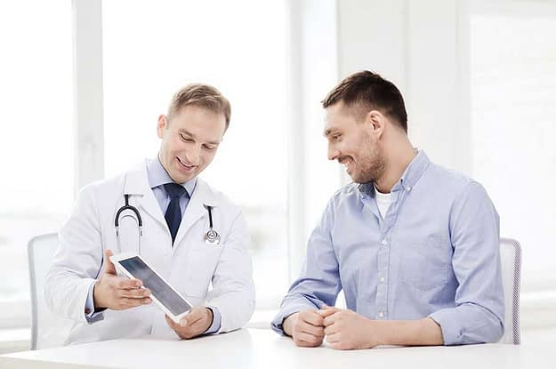 man talking to doctor about detox centers