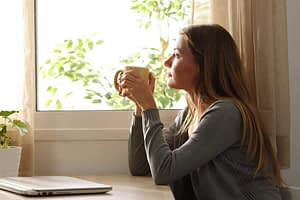 woman drinking coffee needs list of coping skills