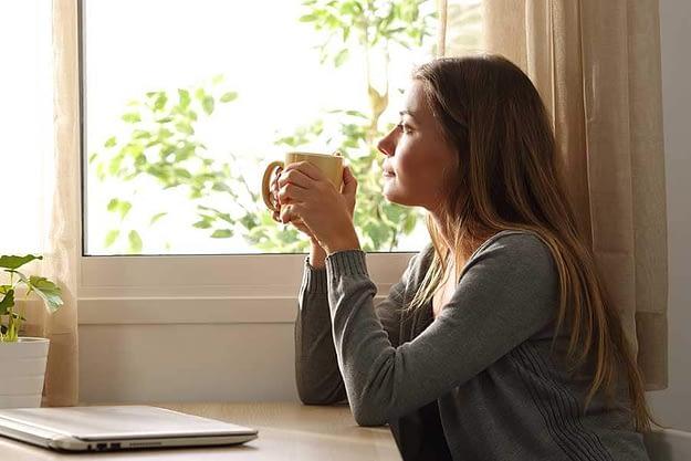 woman drinking coffee needs list of coping skills