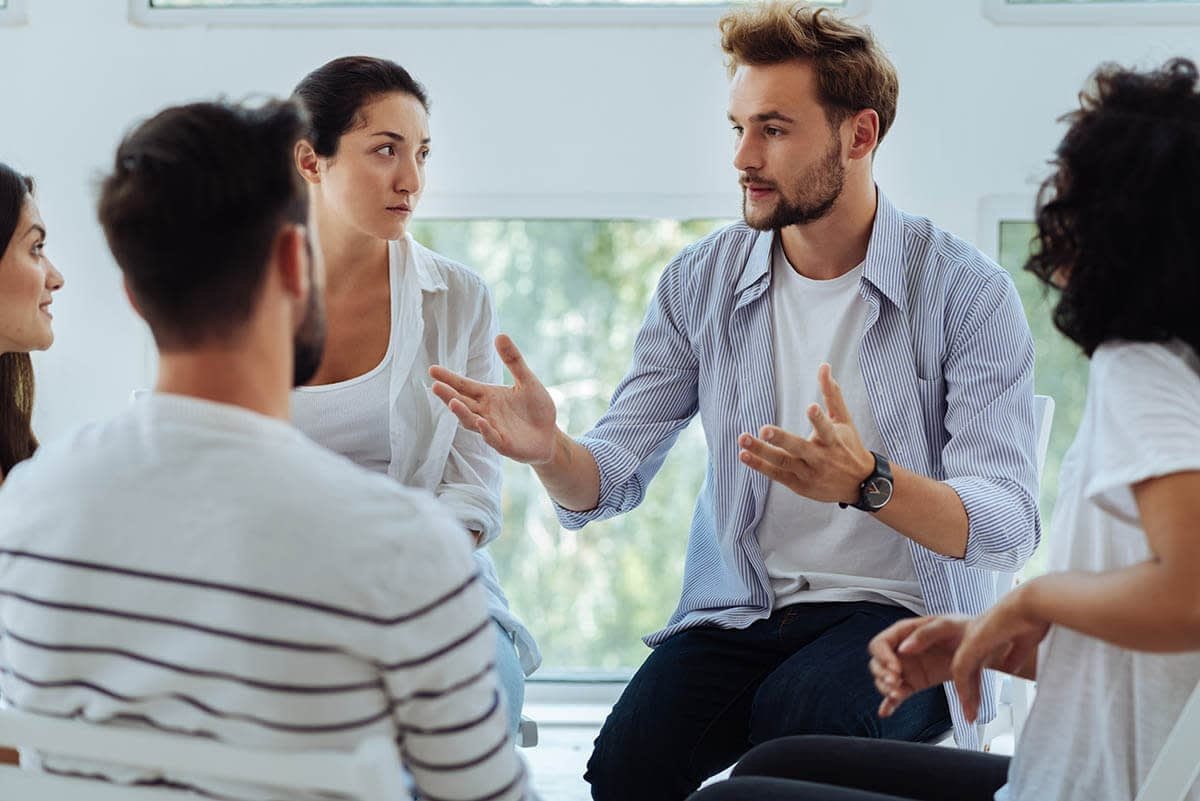 group at a recovery center sharing harm reduction tips