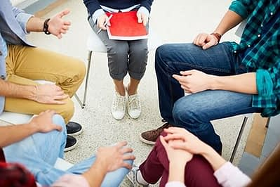 five people at addiction recovery support groups