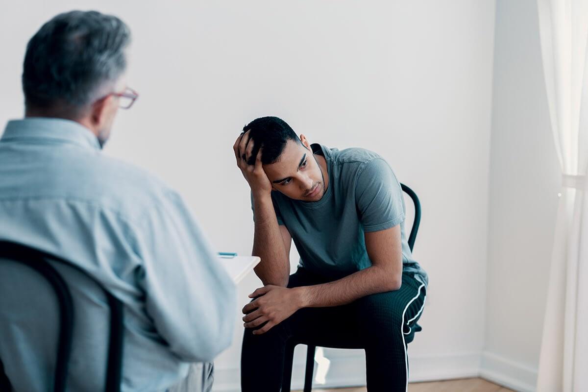 man stressed about ptsd symptoms in women