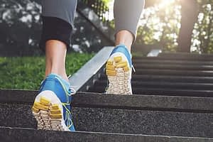 woman running up stairs exercise therapy crestview recovery
