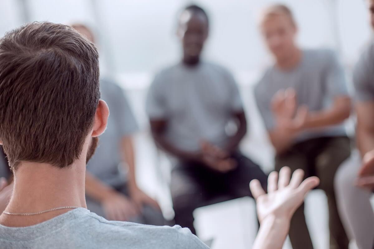 group at a men's opioid rehab program