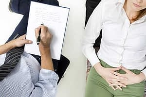 woman talking to therapist wonders what is psychotherapy