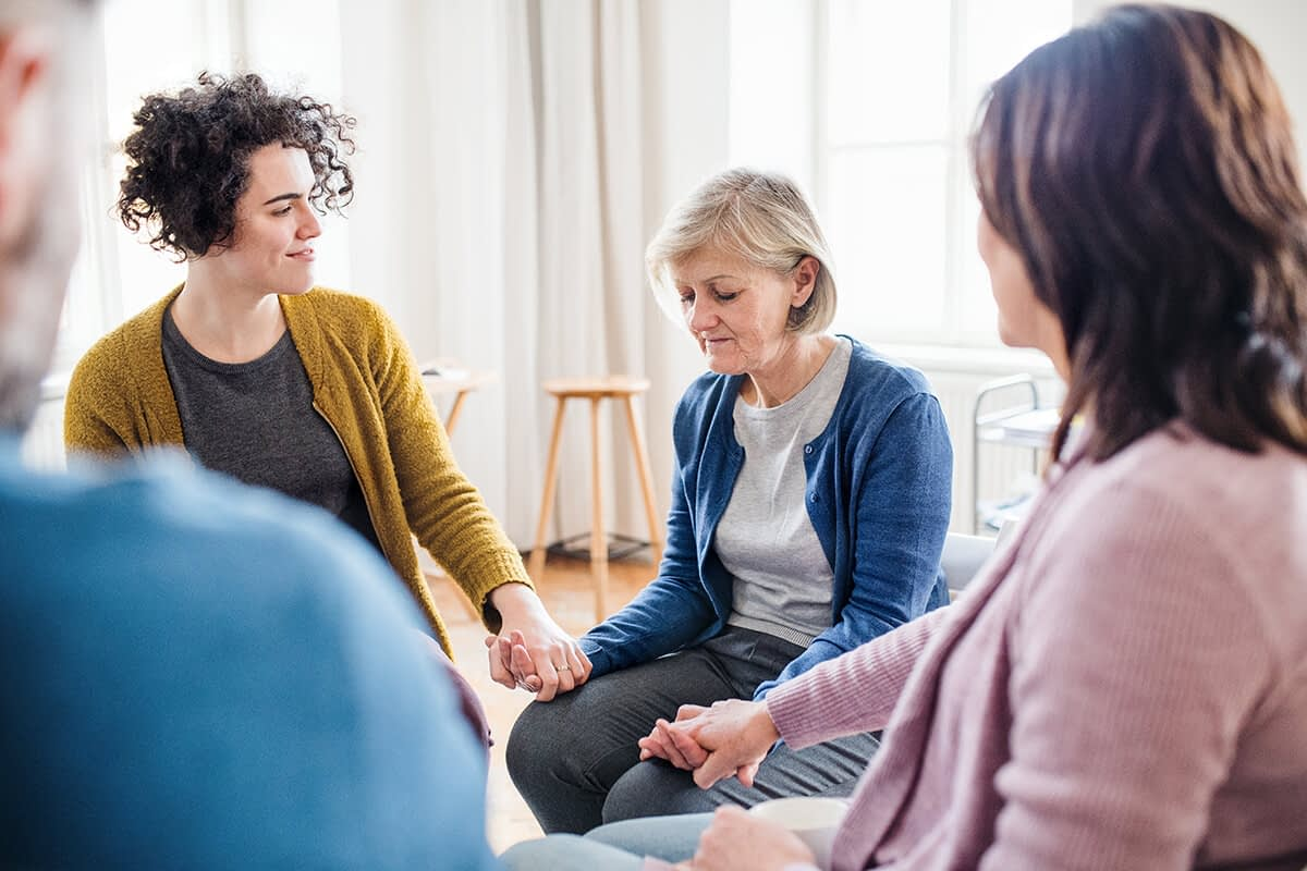 people participating in group therapy in drug rehab